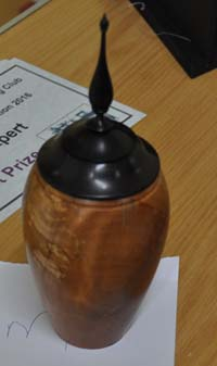 Turned wooden vase with finial